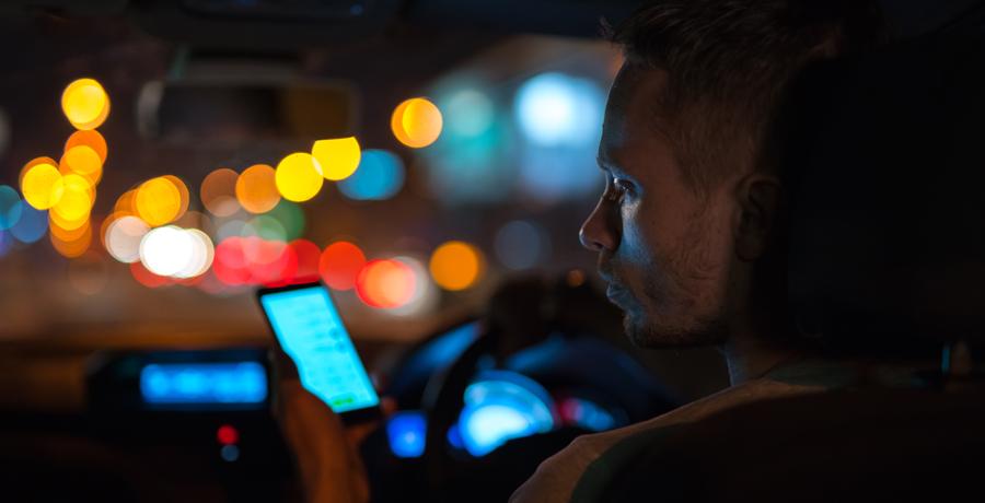 man on phone in car