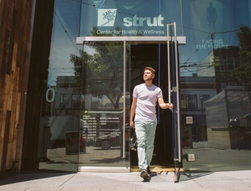 Person walking out of Strut