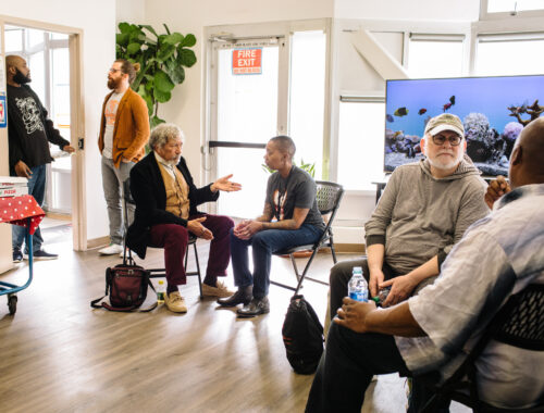 People sitting in a room talking in pairs