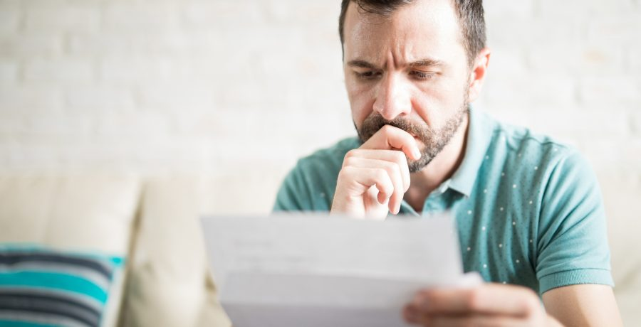 Person looking at report or reading a piece of paper