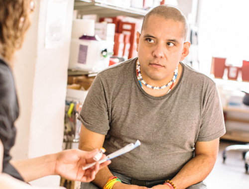 Person receiving Narcan at Harm Reduction Center