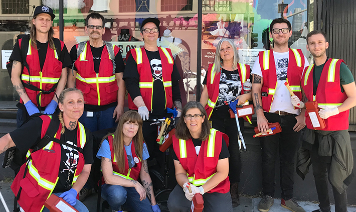 Group photo of syringe disposal volunteers